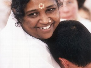 Amma gives a hug