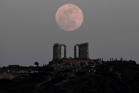 """Supermoon"" rises behind the Temple of Poseidon in Cape Sounion, Greece"