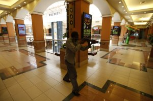 Armed Police search for more attackers at mall.