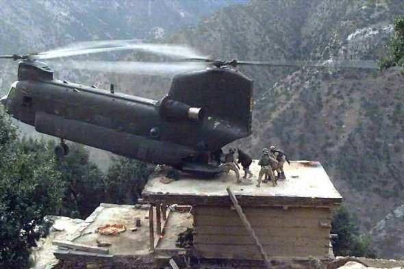 A PA National Guard pilot who flies in civilian life is loading wounded in Afghanistan while perching on this building.  Amazing!