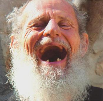 man with no teeth laughing