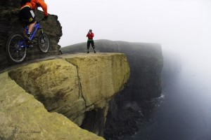 Extreme biking on cliffs of Moher