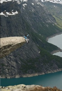 Sitting on Trolltunga Rock in Norway