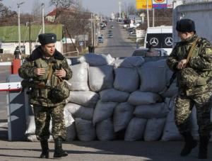 Ukrainian border guards at checkpoint of Transnistria region