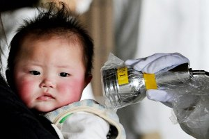 Health risks for years to come. Baby being checked for leaked radiation.