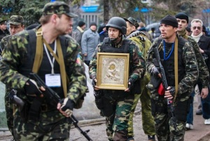 Pro-Russians carry icon taken from government office.