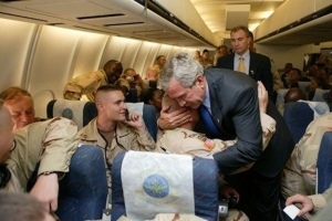 Pres Bush gives hug