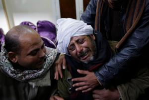 Egyptian Coptic Christians mourn at the Virgin Mary Church in the village of el-Aour.  AP photo