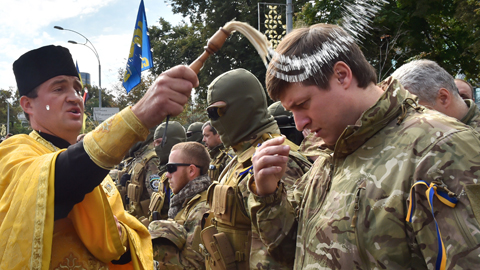 Ukraine Volunteers are blessed before having to battle the Pro-Russian Separatist.
