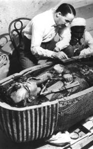 Howard Carter exams sarcophagus of King Tut