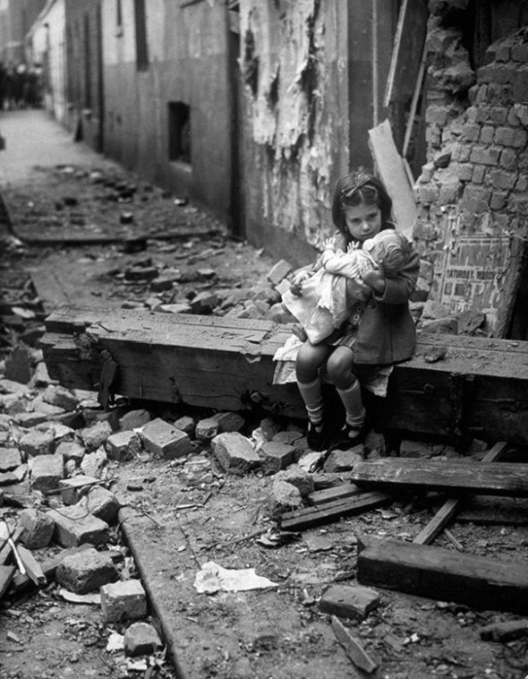 girl and doll in wwii bombing of London