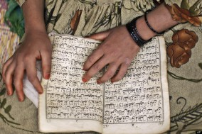 young girl read Koran in her school.jpg