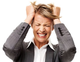 Frustrated Businesswoman Tearing Out Hair