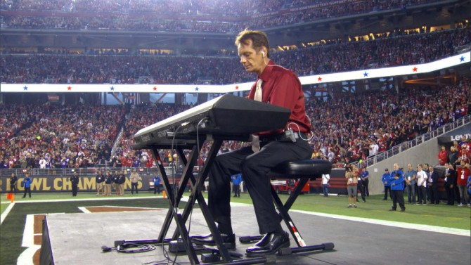 Donald Gould playing National Anthem at football game