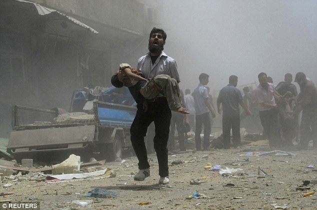 man carries child in Syria