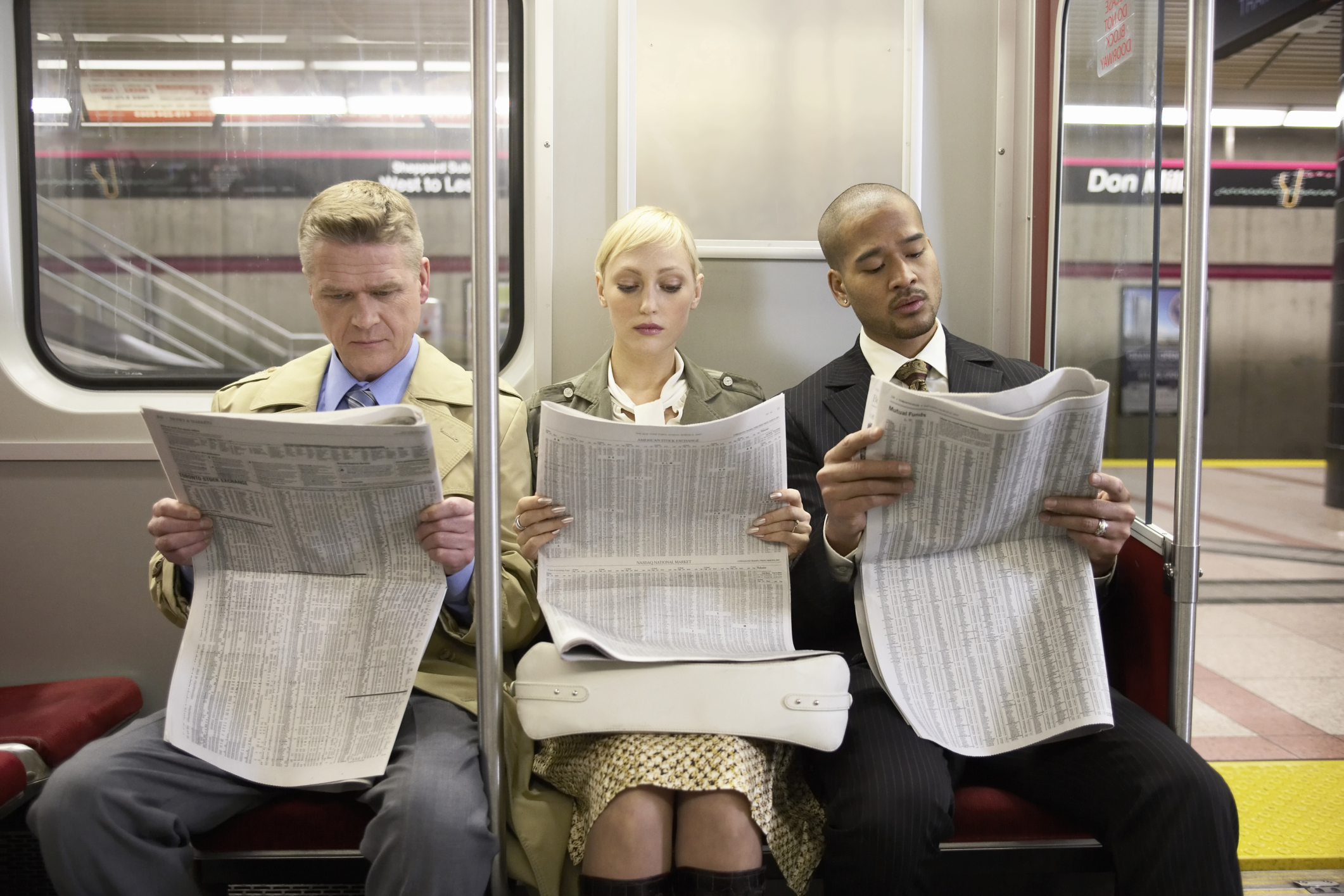 people reading a newspaper2