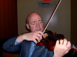 david-russell UNC plays violin belonged to Auschwitz Men's Corchestra Rose of WFAE