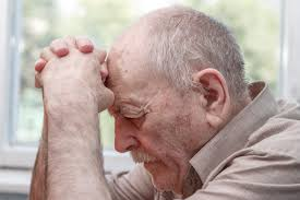 older man praying