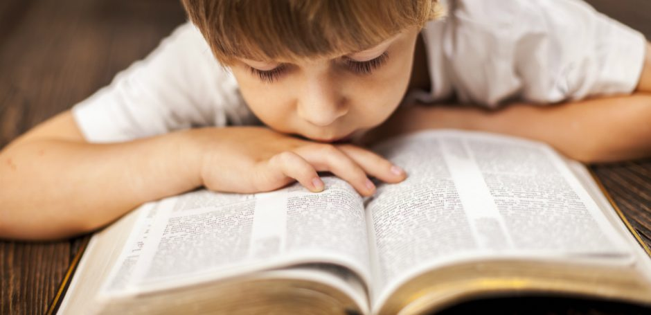 bible reading by child
