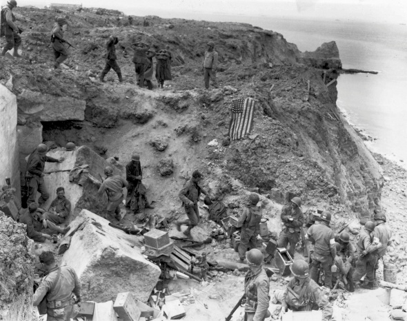 FILE PHOTO: Handout photo of a U.S. flag used as a marker on a destroyed bunker at Pointe du Hoc
